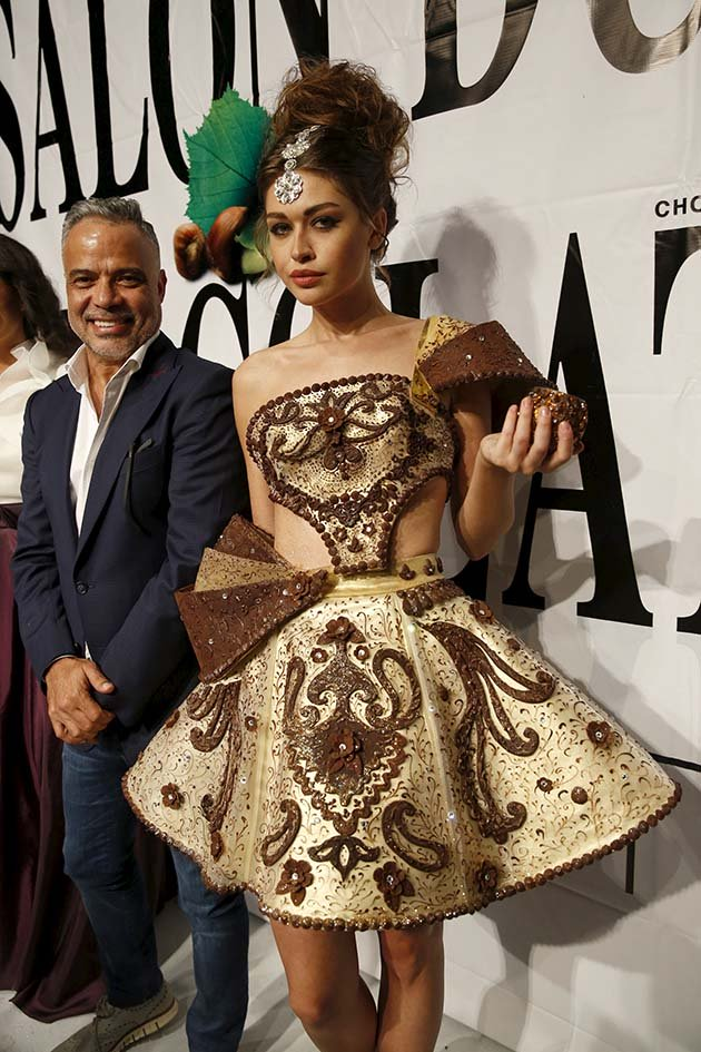 Lebanese designer Abed Mahfouz poses with a model wearing his creation made with chocolate at the end of the Chocolate Fashion Show at the Salon Du Chocolate in Beirut