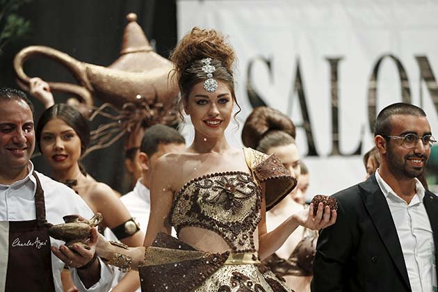 A model presents a creation made with chocolate by Lebanese designer Abed Mahfouz during a Chocolate Fashion Show at the Salon Du Chocolate in Beirut, Lebanon